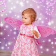 Adorable baby girl with fairy wings - Stock Photo