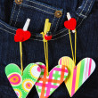 Valentine`s card with hearts on denim pocket — Stock Photo