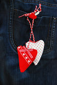 Hearts on denim background — Stock Photo