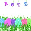 Easter border with colorful eggs in the grass — Stock Photo
