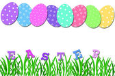 Easter card with eggs in row and grass — Stock Photo