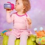Baby girl drinking an apple juice — Stock Photo #20725933