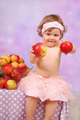 Baby girl with apples — Stock Photo
