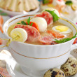 Easter white borscht with quail eggs and sausage - Stock Photo