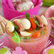 Easter white borscht with quail eggs and sausage in pink glass — Stock Photo #21013045