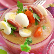 Easter white borscht with quail eggs and sausage in pink glass — Stock Photo #21013061