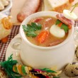 Easter white borscht with quail eggs and sausage in rural style — Stock Photo