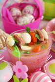 Easter white borscht with quail eggs and sausage in pink glass — Stock Photo