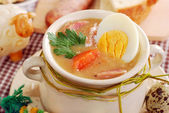 Easter white borscht with eggs and sausage in rural style — Stock Photo