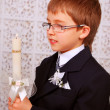 Boy with candle in day of the first holy communion — Stock Photo