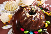 Chocolate ring cake with almonds and nuts topping for easter — Stock Photo