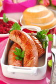 Grilled white sausage with beetroot sauce for easter — Stock Photo
