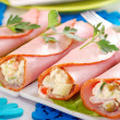 Ham rolls stuffed with vegetable salad and mayonnaise - Stock Photo