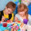 Stock Photo: Young girl and boy painting easter eggs