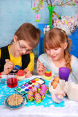 Young girl and boy painting easter eggs — Stock Photo