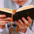Praying boy going to the first holy communion — Stock Photo #21620599