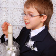 Praying boy going to the first holy communion - Stock Photo