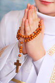 Praying boy going to the first holy communion — Stock Photo