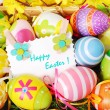 Background with easter painted eggs and greeting card — Stock Photo