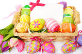 Decoration with easter painted eggs and greeting card — Stock Photo