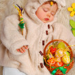 Stock Photo: sleeping baby girl as easter sheep