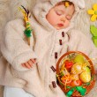 图库照片: sleeping baby girl as easter sheep