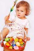 Baby girl and easter basket with eggs — Stock Photo