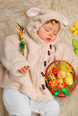 sleeping baby girl as easter sheep — ストック写真