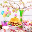 Easter table decoration with ring cake and basket — Stock Photo #22176411