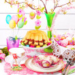 Easter table decoration with ring cake and basket — Stock Photo #22176415