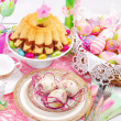 Stock Photo: Easter table decoration with ring cake and basket