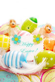 Colorful easter eggs and greetings card — Stock Photo