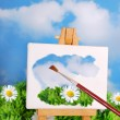 Brush painting spring landscape on easel — Stock Photo
