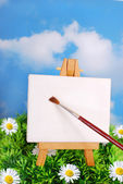 Easel standing on the grass — Stock Photo