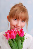 Beautiful girl with bouquet of tulips — Stock Photo