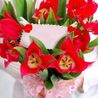 Stock Photo: Bouquet of red tulips with ticket for message