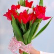 Bouquet of red tulips with ticket for message — Stock Photo #24798809