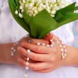 Lily of the valley bunch for the first holy communion — Stock Photo #25648867