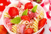 Fusilli pasta with strawberry for child — Stock Photo