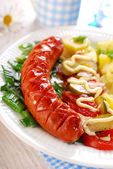 Grilled sausage,vegetable salad and potato — Stock Photo