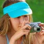 Girl taking photos by digital camera — Stock Photo #27833777