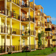 New yellow block of flats — Stock Photo #28130297