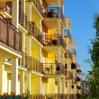 Stock Photo: New yellow block of flats