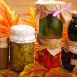 Stock Photo: Jars of homemade preserves in autumn scenery