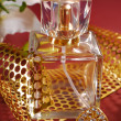Bottle of perfume with gold decoration — Stock Photo