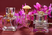 Perfume and pink orchids — Stock Photo