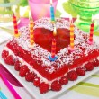 Raspberry jelly cake with birthday candles — Stock Photo