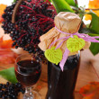 Elderberry juice and fresh fruits in the basket — Stock Photo