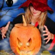 Witch with pumpkin — Stock Photo