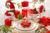 Christmas table decoration with red candles — Stock Photo
